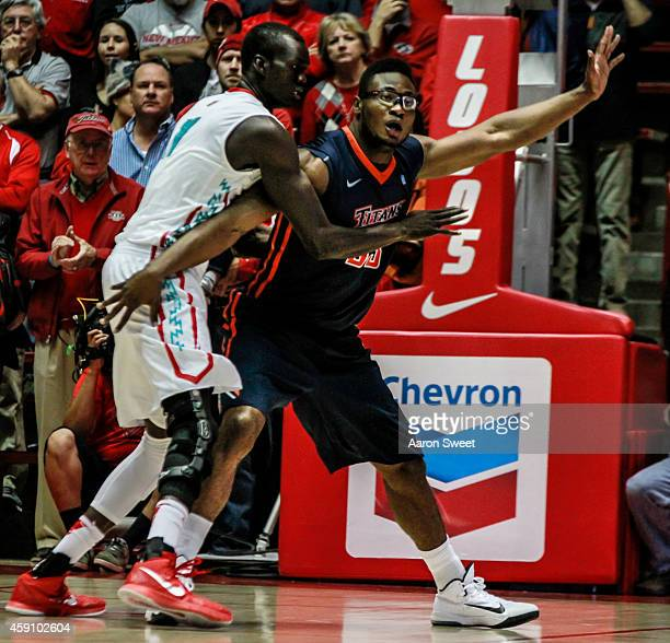 obij aget of the new mexico lobos guards kennedy esume of the cal state fullerton titans