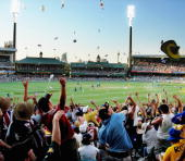 Objects are thrown into the air as a mexican wave erupts around 'The Hill' during a cricket match between Australia and Sri Lanka at the Sydney...