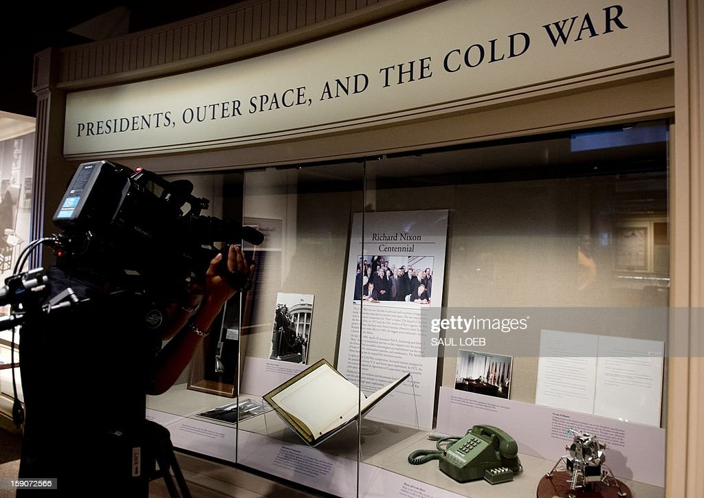 Objects from the presidency of Richard Nixon and related to the US space program are displayed as part of a new exhibit at the National Archives in Washington on January 7, 2013. The exhibit, 'Nixon and the US Space Program,' features rarely seen documents, photographs and objects representating milestones in manned spaceflight from the Nixon administration, including the telephone used by Nixon to talk with Apollo 11 astronauts after the moon landing, tongs used by Apollo 12 astronauts to collect moon rock samples and a contingency speech drafted in case of disaster during the 1969 Apollo 11 lunar landing mission. AFP PHOTO/Saul LOEB