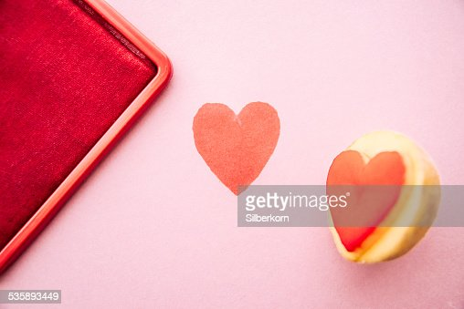 Objects: Heart shaped potato stamp on pinkpaper : Stock Photo