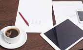 Objects of a young entrepreneur, workplace, business plan for a successful startup.