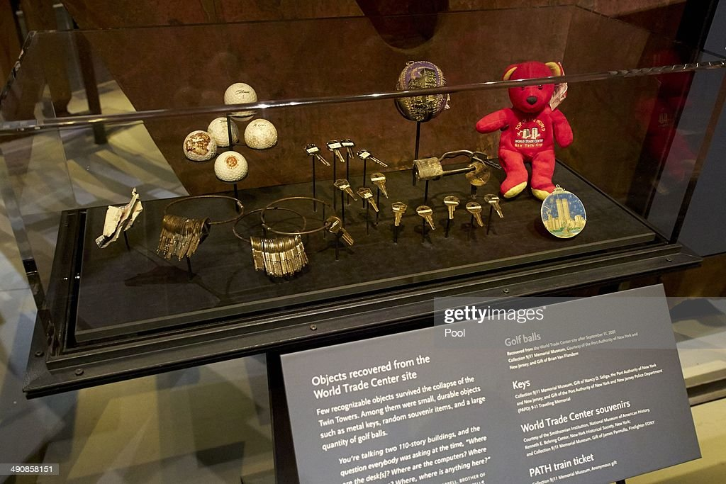 Objects recovered from the World Trade Center site are displayed during a press preview of the National September 11 Memorial Museum at ground zero May 15, 2014 in New York City. The museum spans seven stories, mostly underground, and contains artifacts from the attack on the World Trade Center Towers on September 11, 2001 that include the 80-foot high tridents, the so-called 'Ground Zero Cross,' the destroyed remains of Company 21's New York Fire Department Engine as well as smaller items such as letter that fell from a hijacked plane and posters of missing loved ones projected onto the wall of the museum. The museum will open to the public on May 21.
