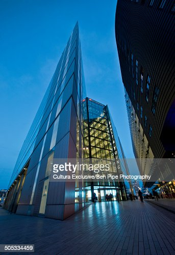 Oblique angled modern building at night, London, UK