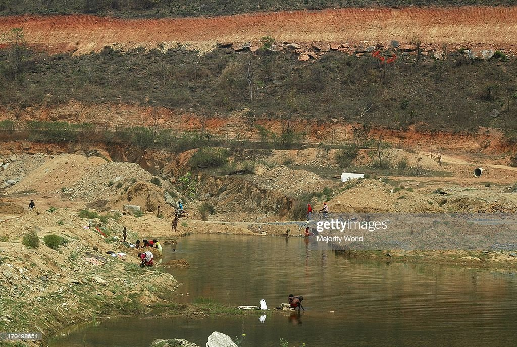 Oblivious to what radioactive uranium tailings disposed of into water can cause villagers wash and bathe in the rivers In reality the waste material...
