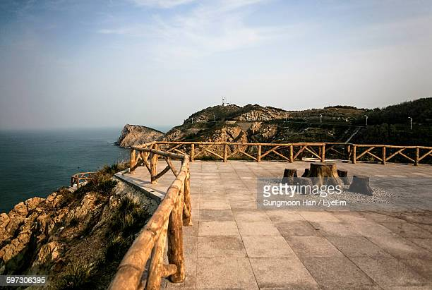 Observation Point On Cliff By Sea Against Sky