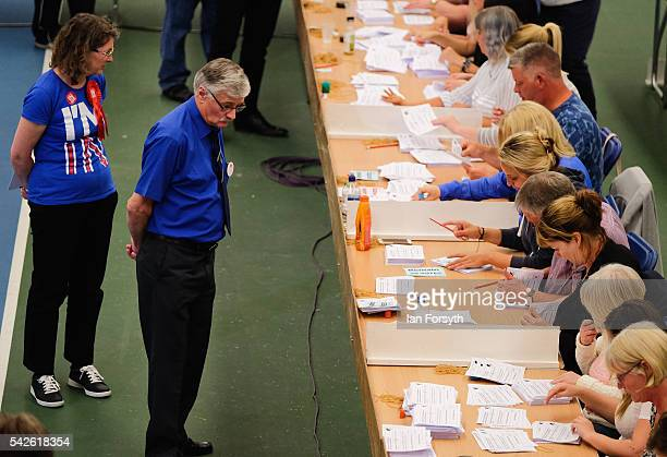 Observers look on as the North East region European Union referendum count takes place on June 23 2016 in Sunderland United Kingdom The United...