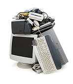 Pile of obsolete computer hardware ready to be recycled. Image is isolated on a white background.