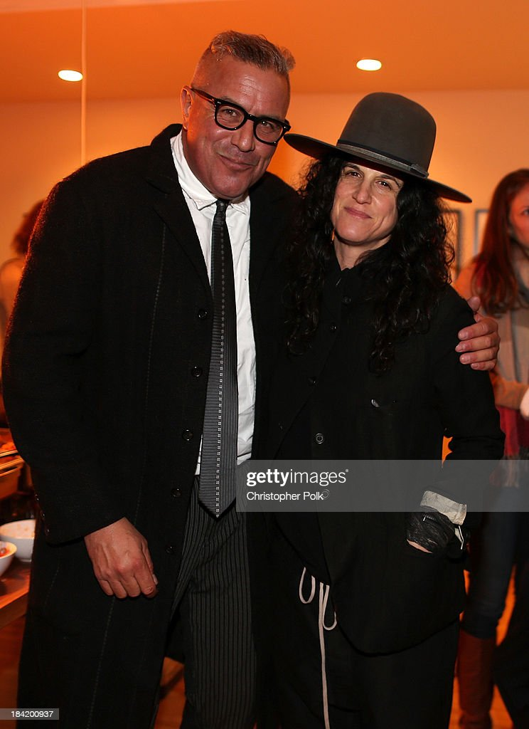Obsolete gallery owner Ray Azoulay and artist Amanda Demme attend the screening for 'The Square' at the home of Maria Bello on October 11, 2013 in Santa Monica, California.