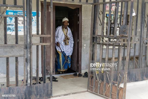 Obung community village leader Chief Ntufam Igne comes out of the community palace on April 26 in Calabar The 800billionnaira highway project...