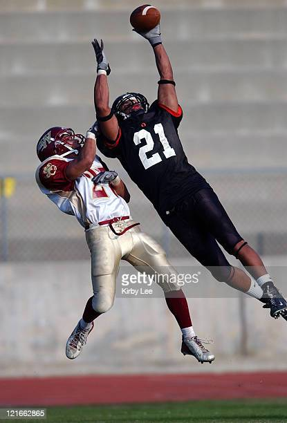 Occidental College junior receiver Josh Jones leaps over Williamette defensive back Tyler Gill for a reception during 2814 victory in NCAA Division...