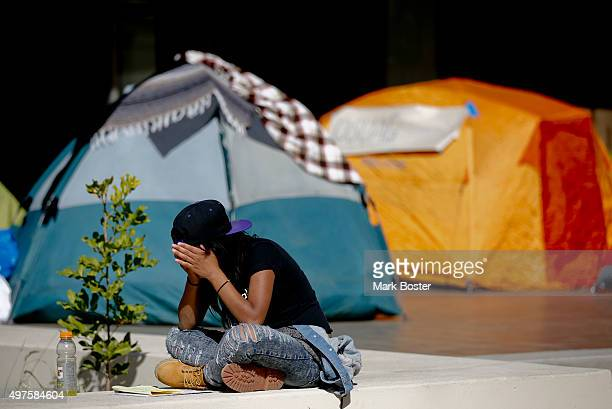 Occidental College student Dayja Tillman studies near a few of the tents on the second day occupying the Walter G Coons Administrative Center in...