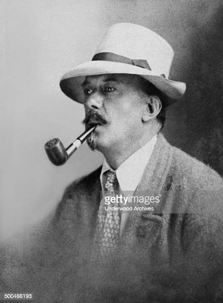 Occulist writer and mountaineer Aleister Crowley smoking a pipe England circa 1905