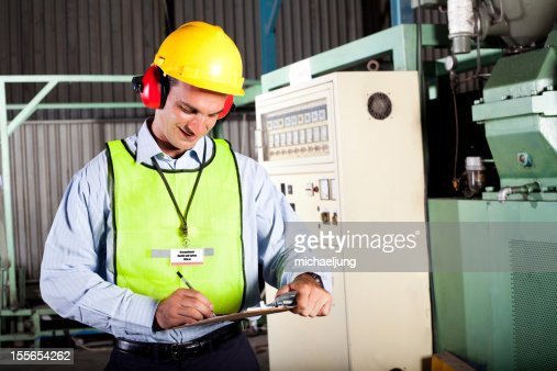 Occupational health and safety officer in factory : Stock Photo