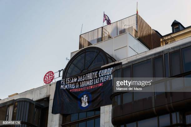 Occupied building by far right group Hogar Social shows a banner that reads 'Islam destroys Europe as we open the doors Terrorists welcome' Banner...