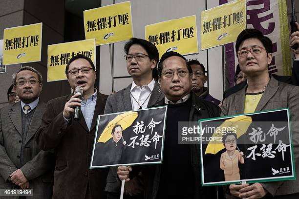 Occupy Central leader Benny Tai says a few words to the media as legislators Charles Mok Albert Ho and Helena Wong stand by outside the Wanchai...