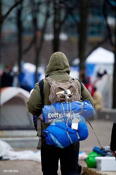Occupy Philly protesters pack up their belongings prior to a 5 pm deadline to clear the encampment November 27 2011 in Philadelphia Pennsylvania The...