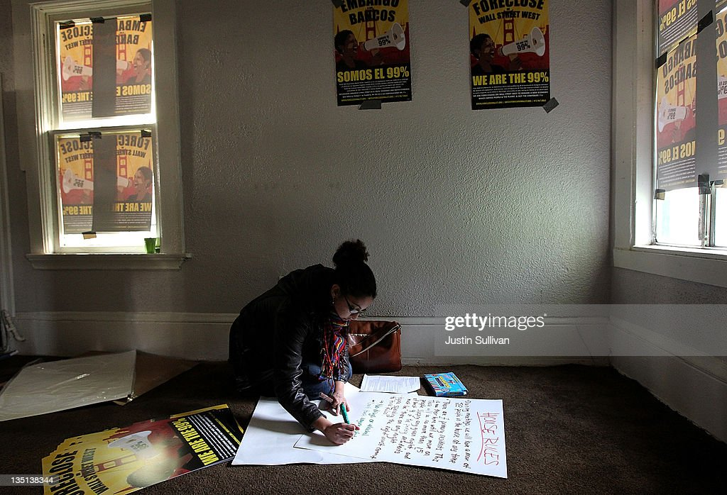 Occupy protester Paige Kumm makes a list of house rules in a foreclosed home that protestors re-occupied on December 6, 2011 in Oakland, California. Occupy Wall Street groups across the country are staging a day of action against home foreclosures and are protesting outside banks and attempting to re-occupy homes that have been foreclosed.