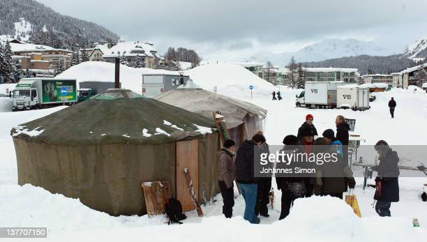 Occupy protesters and media representatives meet next to yurts and igloos at protesters' encampment on January 25 2012 in Davos Switzerland Several...
