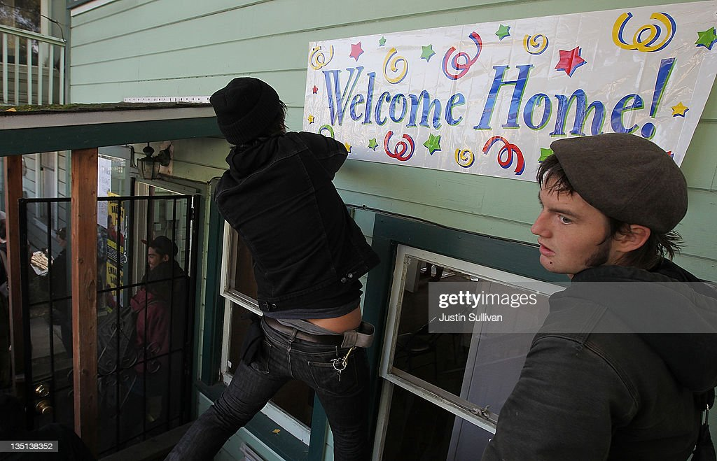 Occupy protesters hang a 'welcome home' banner on the front of a foreclosed home that they re-occupied on December 6, 2011 in Oakland, California. Occupy Wall Street groups across the country are staging a day of action against home foreclosures and are protesting outside banks and attempting to re-occupy homes that have been foreclosed.