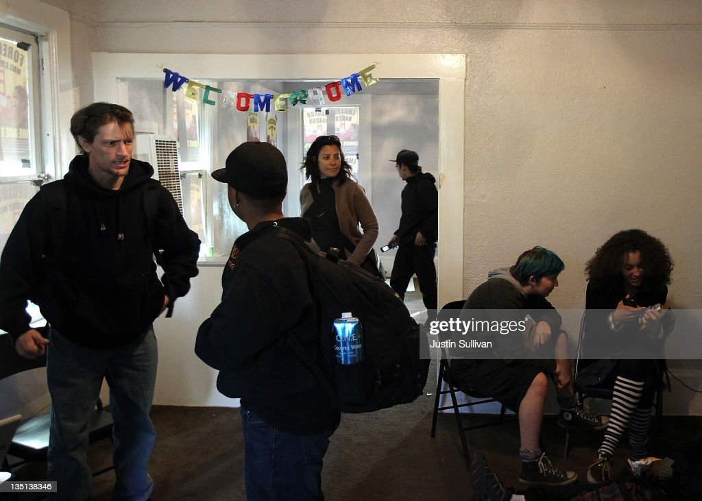 Occupy protesters hang out in a foreclosed home that they re-occupied on December 6, 2011 in Oakland, California. Occupy Wall Street groups across the country are staging a day of action against home foreclosures and are protesting outside banks and attempting to re-occupy homes that have been foreclosed.