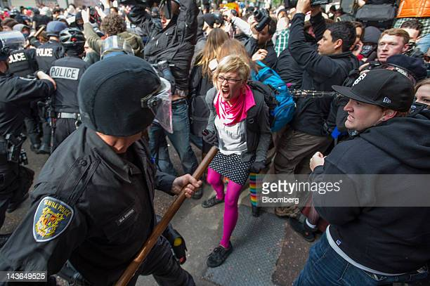 Occupy Seattle protesters an offshoot of the Occupy Wall Street movement face off with police officers during a May Day rally and anticapitalist...