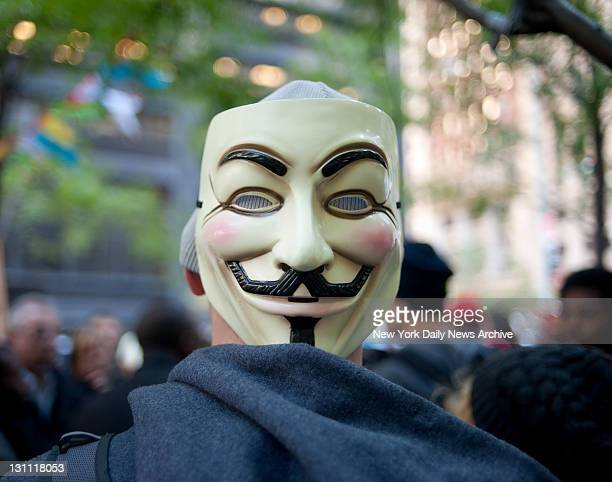 Anticapitalist protesters demonstrate against Wall St corporate greed A protester dons a Guy Fawkes mask at Zuccotti Park as the Occupy Wall Street...