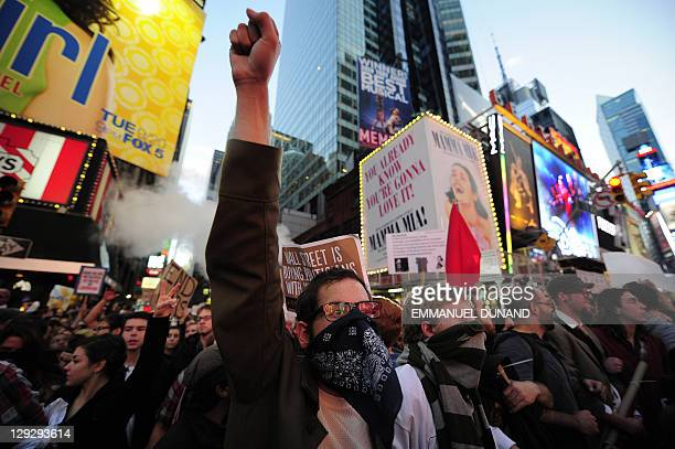 Occupy Wall Street participants link arms to try to push trough police barricade as the authorities stop them to take their demonstration onto the...