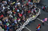Occupy Wall Street participants stage a march down Broadway as part of May Day celebrations in New York May 01 2012 AFP PHOTO/Emmanuel Dunand