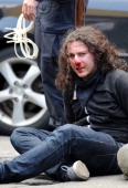Occupy Wall Street protester with a bloodied face is arrested on Broadway as the movement joins with activists groups for May Day demonstrations May...