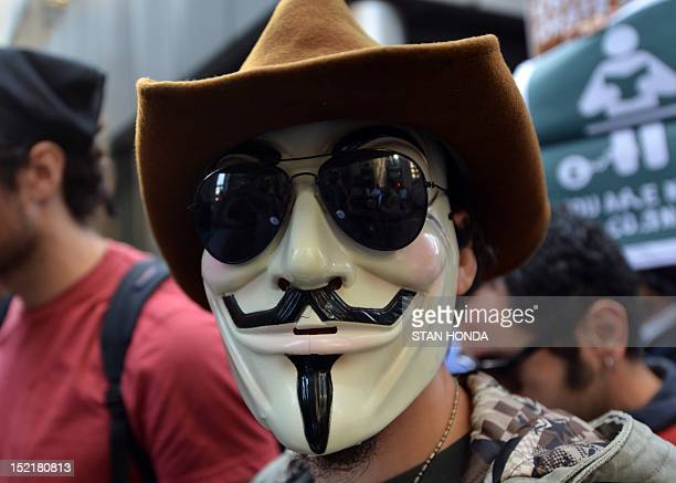 Occupy Wall Street protester with a mask and sunglasses September 17 2012 on the one year anniversary of the movement in New YorkPolice in New York...