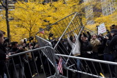 Occupy Wall Street protesters remove police barricades in Zuccotti Park on November 17 2011 in New York City Hundreds of protesters attempted to shut...