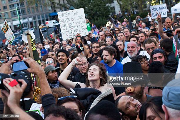 Occupy Wall Street protestors dance and sing during a concert given by Tom Morello former lead singer of the band 'Rage Against the Machine' in Foley...