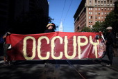 Occupy Wall Street protestors hold a large banner during a demonstration on September 17 2012 in San Francisco California An estimated 100 Occupy...