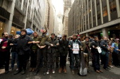 Occupy Wall Street protestors lock arms and block access to the New York Stock Exchange area November 17 2011 in New York Some 1000 protesters...