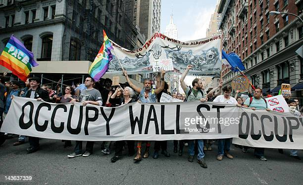 Occupy Wall Street protestors march down Fifth Avenue towards Union Square during a May Day rally on May 1 2012 in New York City Demonstrators have...