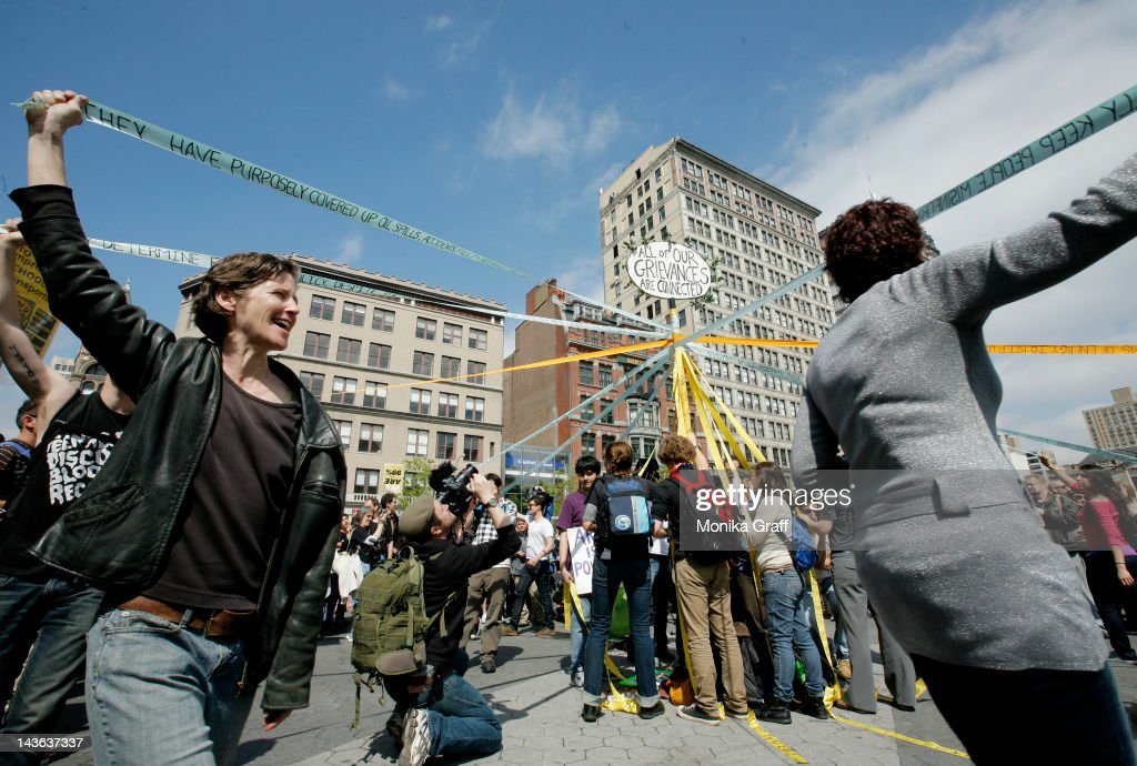 Occupy Wall Street protestors weave a May Pole as demontrators gather in Union Square during a May Day rally on May 1, 2012 in New York City. Demonstrators have called for nation-wide May Day strikes to protest economic inequality and political corruption.