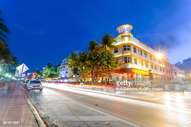 Ocean drive art deco scene with lights on, Miami.