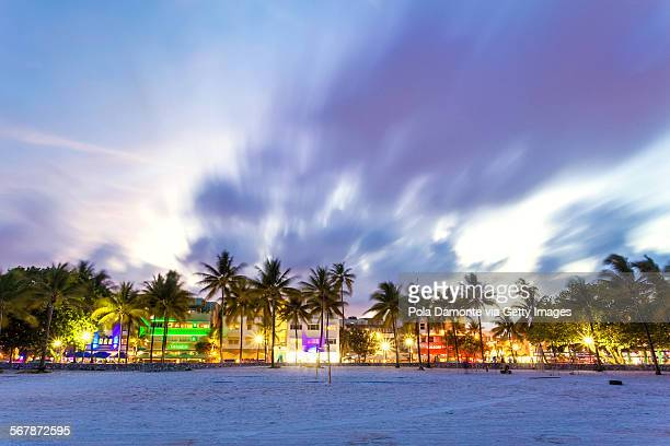 Ocean Drive evening scene with lights on, Miami