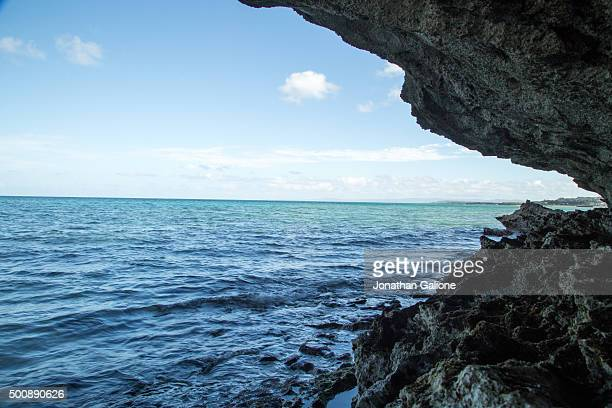 Ocean lapping against rock face