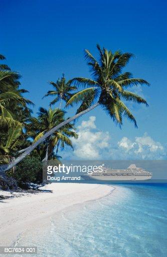 Ocean liner off shores of tropical island, Cook Islands (Composite) : Stock Photo