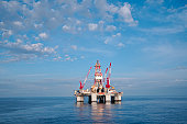 Ocean oil drilling platform and sky