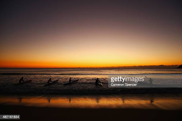 Ocean paddlers train on surf ski's at Manly Beach on July 28 2015 in Sydney Australia