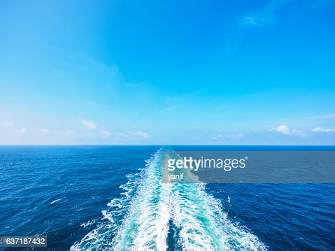 Ocean wake from cruise ship, on bright summer day. : Stock Photo