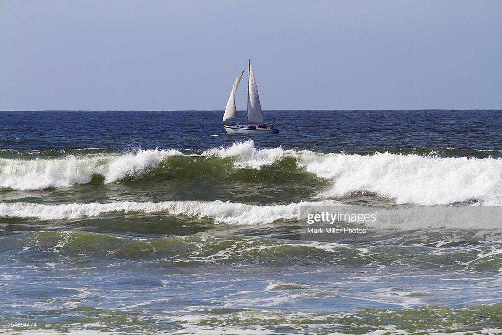 Ocean waves and Sailboat at sea : Stock Photo