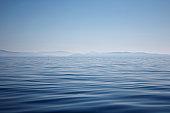 Ocean with mountains on horizon