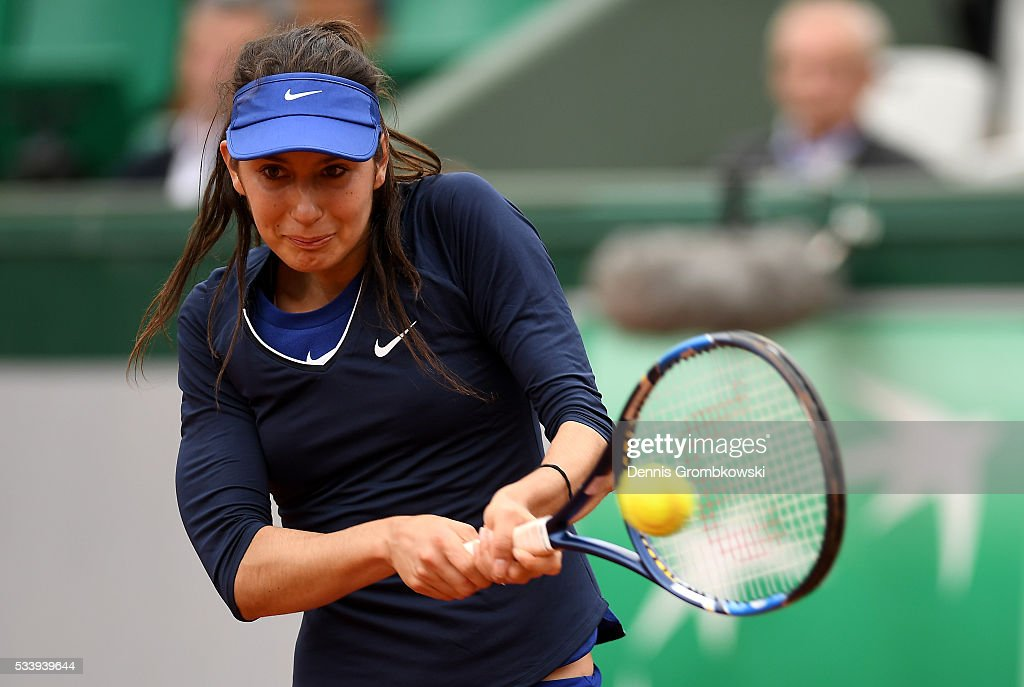 <a gi-track='captionPersonalityLinkClicked' href=/galleries/search?phrase=Oceane+Dodin&family=editorial&specificpeople=9453178 ng-click='$event.stopPropagation()'>Oceane Dodin</a> of France plays a backhand during the Women's Singles first round match against Ana Ivanovic of Serbia on day three of the 2016 French Open at Roland Garros on May 24, 2016 in Paris, France.