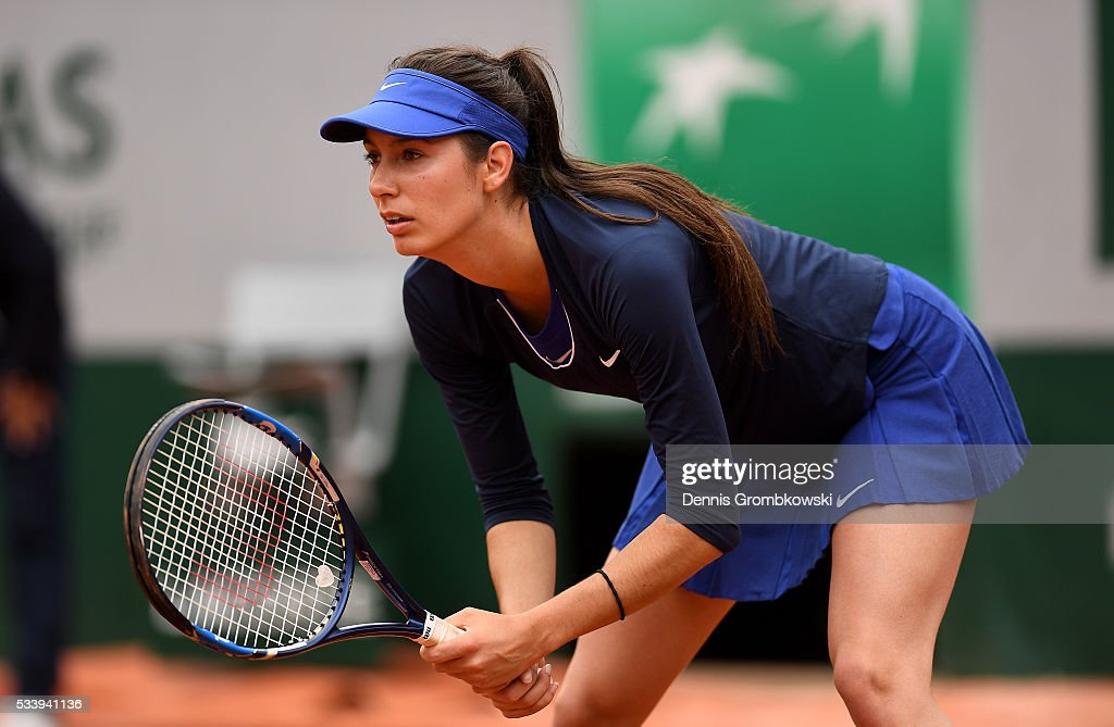 Oceane Dodin of France prepares to return a serve during the Women's Singles first round match against Ana Ivanovic of Serbia on day three of the 2016 French Open at Roland Garros on May 24, 2016 in Paris, France.