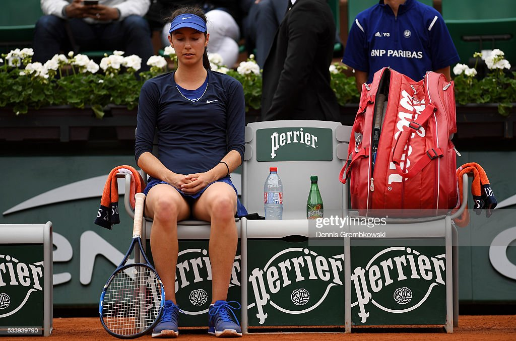 <a gi-track='captionPersonalityLinkClicked' href=/galleries/search?phrase=Oceane+Dodin&family=editorial&specificpeople=9453178 ng-click='$event.stopPropagation()'>Oceane Dodin</a> of France reacts during the Women's Singles first round match against Ana Ivanovic of Serbia on day three of the 2016 French Open at Roland Garros on May 24, 2016 in Paris, France.