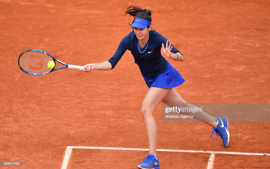 Oceane Dodin of France returns to Ana Ivanovic of Serbia during their women's single first round match at the French Open tennis tournament at Roland Garros in Paris, France on May 24, 2016.