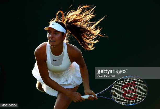 Oceane Dodin of France serves during the Ladies Singles first round match against Lucie Safarova of The Czech Republic on day two of the Wimbledon...